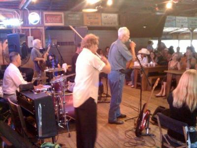 Daddy Frank singing with the band at Gruene Hall